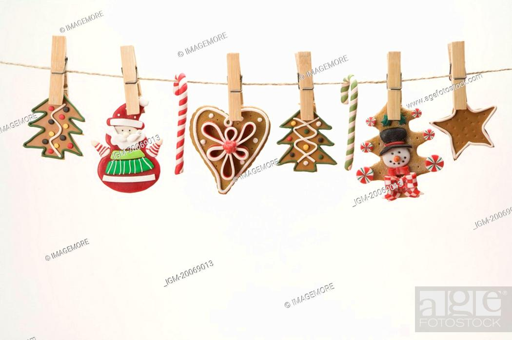 Stock Photo: Gingerbread Cookie on a Clothesline.