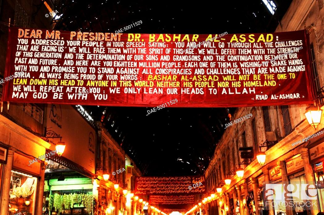 Stock Photo: Syria - Damascus. Public commercial 'suq' area. Banner supports Syrian President Bashar al-Assad.