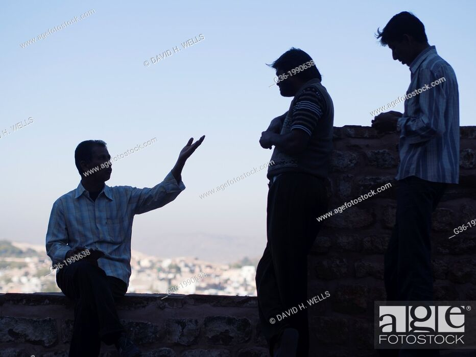 Stock Photo: Silhouette of friends talking at fort in Jodhpur, Rajasthan, India.