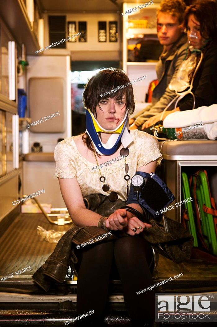 Stock Photo: Injured young woman in an ambulance.
