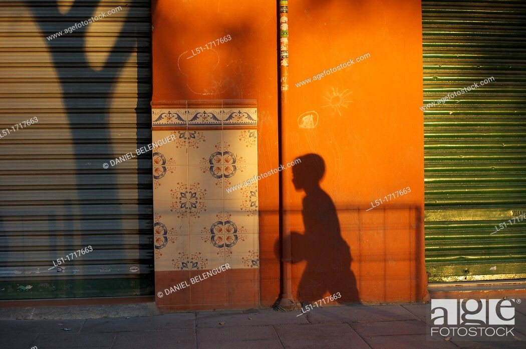 Stock Photo: Shadows of a boy playing football and a tree on a park in Valencia city, Valencia, Spain.