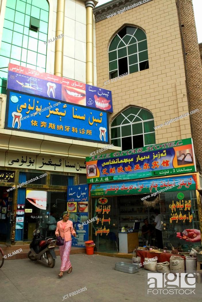 Stock Photo: China, Xinjiang, kashgar, shops facades, woman.