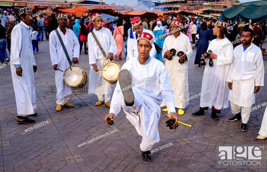 Stock Photo: Men playing drums and performing a traditional dance in the Jemaa el Fna, Marrakech, Morroco, North Africa.