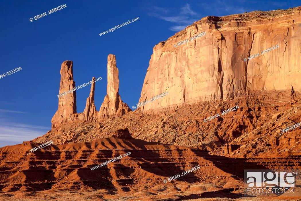 Stock Photo: Early morning view over the Three Sisters rock formation, Monument Valley, Navaho Tribal Park, Arizona USA.