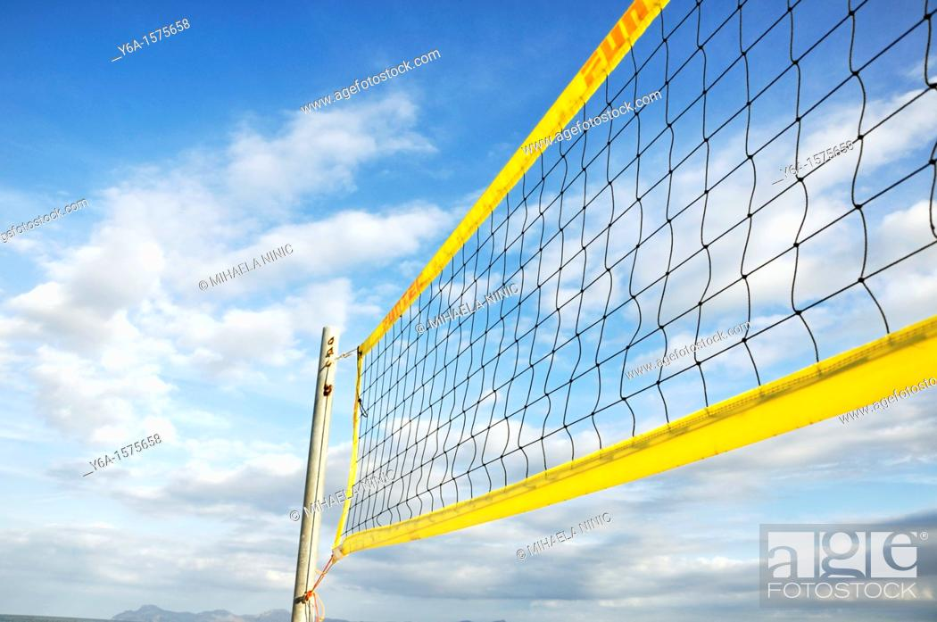 Stock Photo: Detail of a volleyball net on the beach.