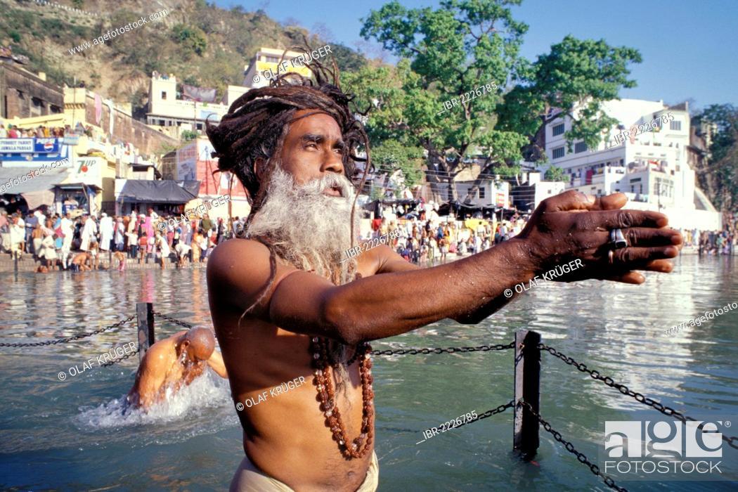 Sadhu during a Hindu morning prayer in the Ganges River, Puja, Kumbh