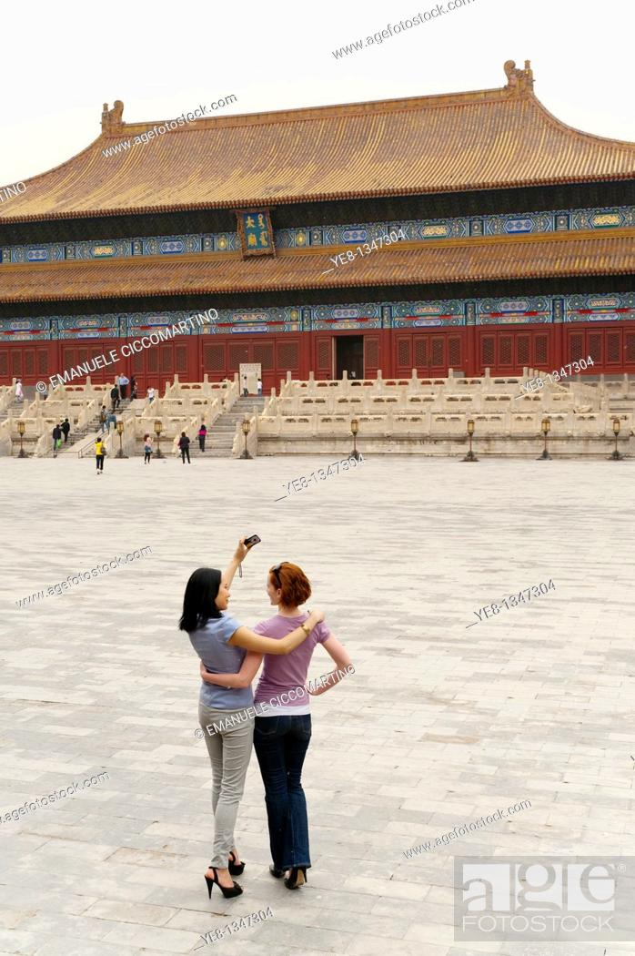 Stock Photo: Tourists taking their own photograph in front of the Hall for Worship Of Ancestors, The Forbidden City, Beijing, China, Asia  MR.