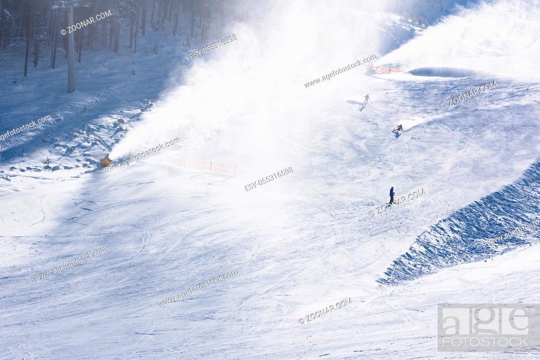 Photo de stock: skier riding down the huge snowfield splashing powder snow.