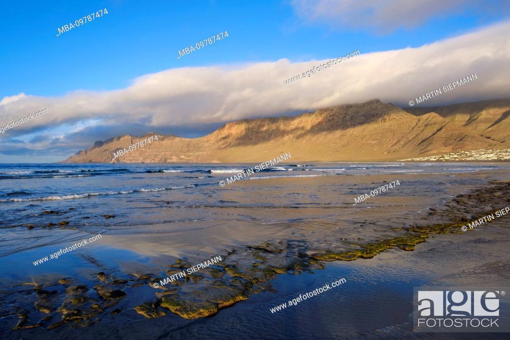 Stock Photo: Beach in Caleta de Famara, Risco de Famara, Lanzarote, Canary Islands, Spain.