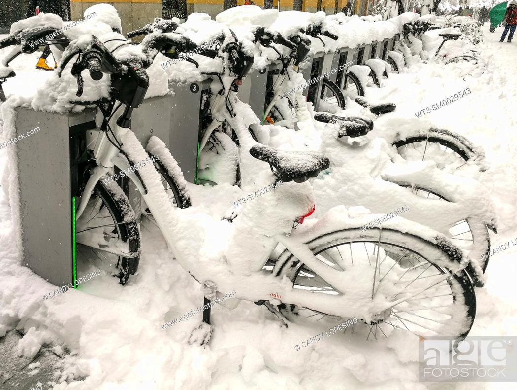 Stock Photo: January 9, 2021, bicycles in Opera square after Storm Filomena brought intense snow, MADRID, SPAIN, EUROPE.