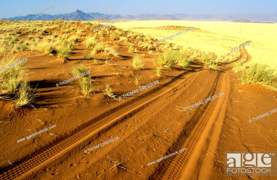Stock Photo: Namibia - Sandy track at the edge of the southern Namib Desert inside the NamibRand Nature Reserve.
