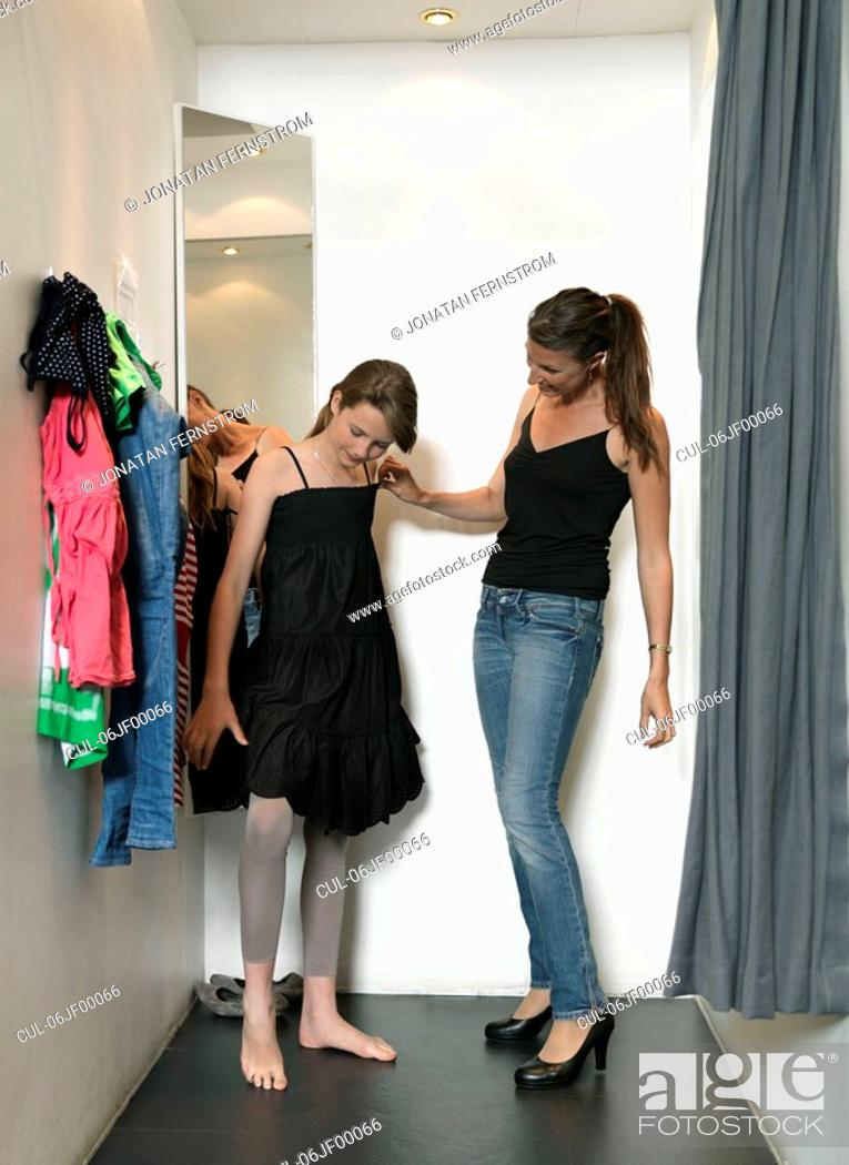 Stock Photo: Mother and daughter in dressing room.