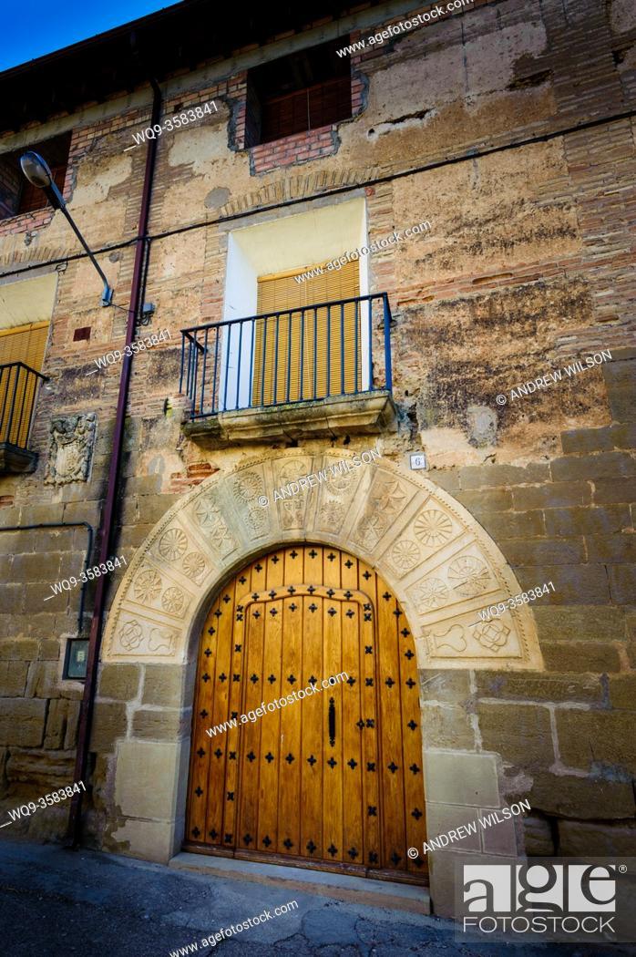 Stock Photo: Ornate doorway in Adahuesca, Huesca, Aragon, Spain.