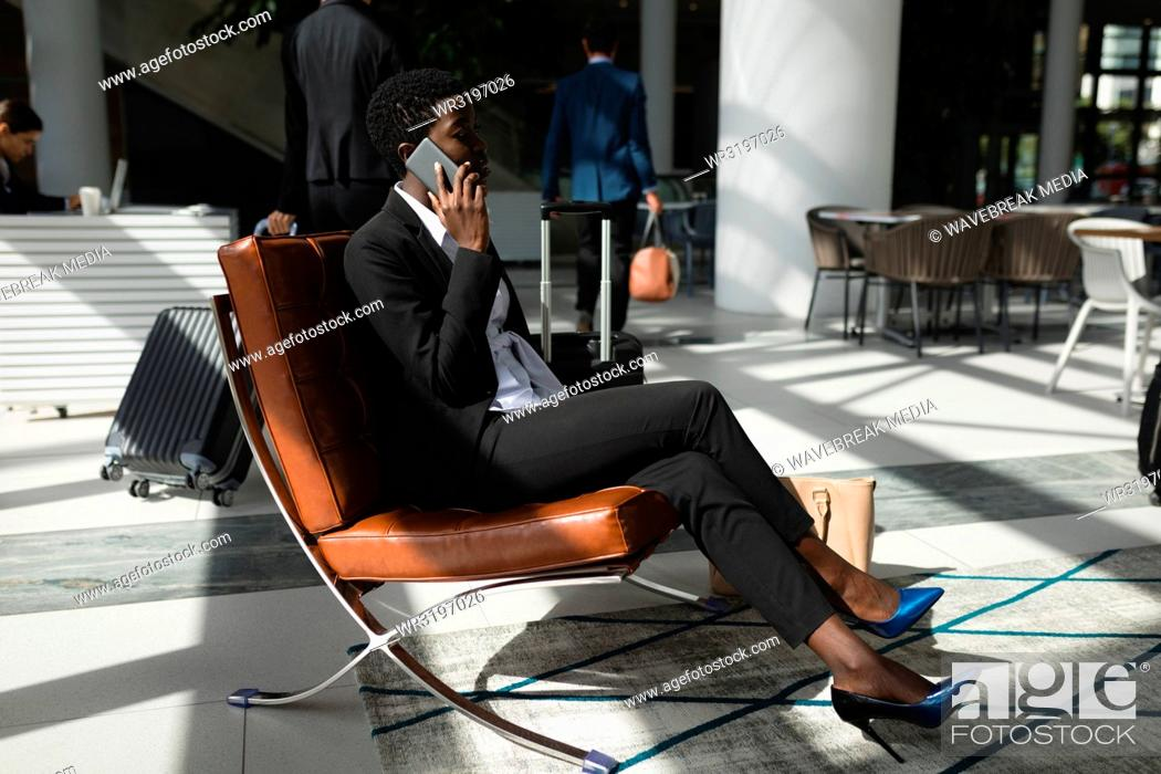 Stock Photo: Businesswoman talking on the phone in office.