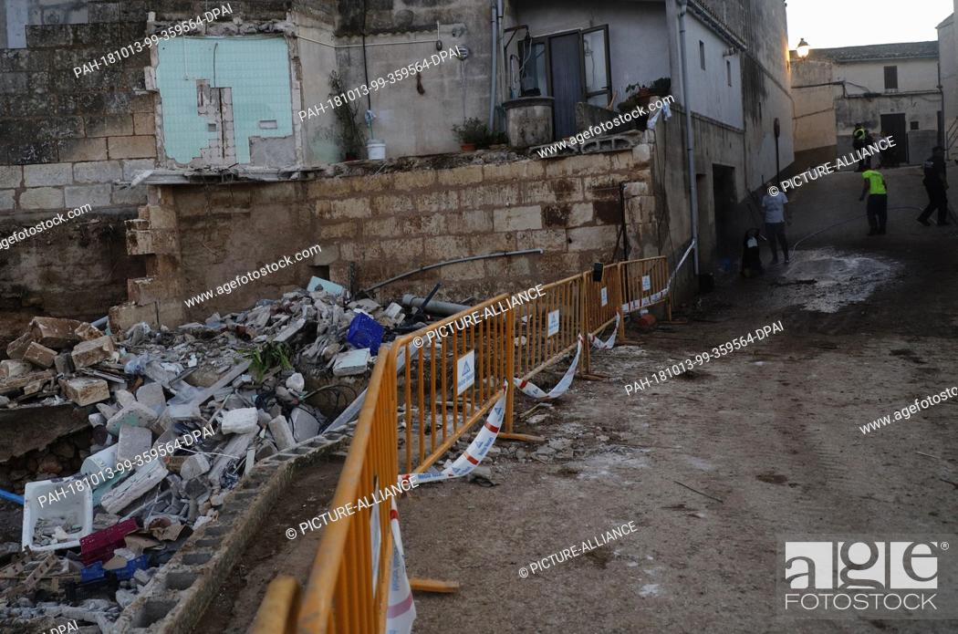 Stock Photo: 13 October 2018, Spain, Son Carrio: 13 October 2018, Spain, Son Carrio: Damaged building next to Can Amer Torrent in the village of Son Carrio after the severe.