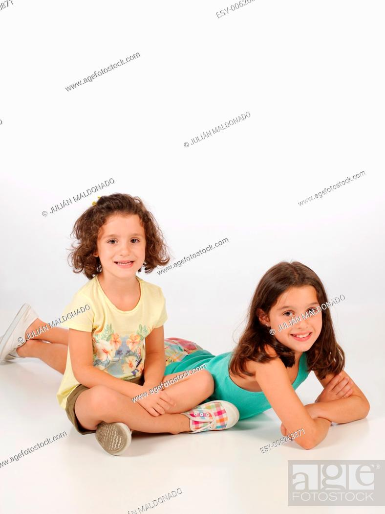 Stock Photo: Girls with cheerful expression.