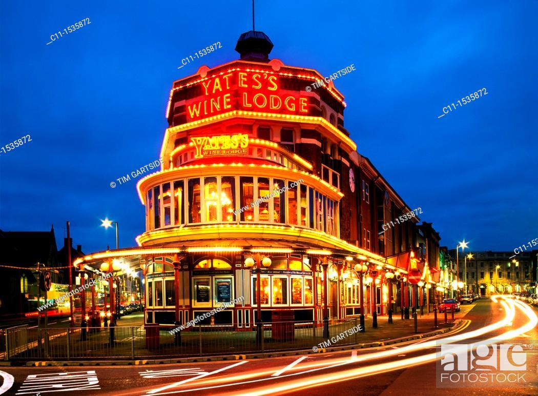 Stock Photo: yates s wine lodge blackpool night england uk illuminations lights city bright cars trails.