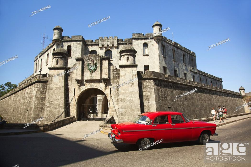 Stock Photo: Old American car used as taxi in front of the Castillo De La Real Fuerza-Castle in Old Havana, La Habana, Cuba, West Indies, Central America.