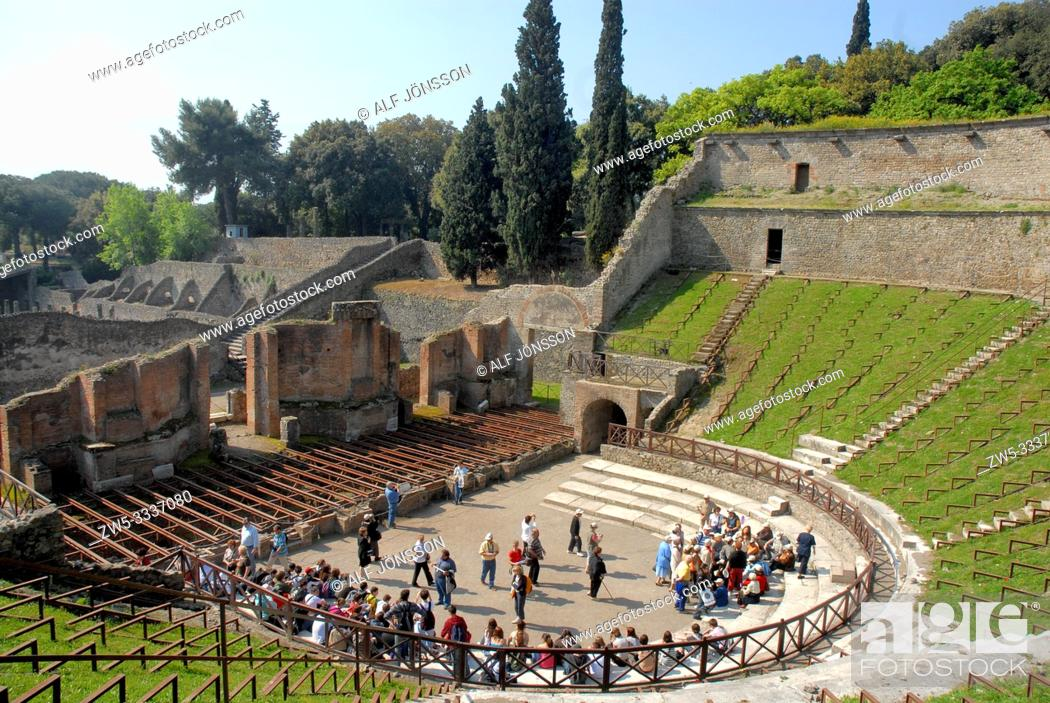 Stock Photo: Tour groups in the Large Theatre, Roman ruins of Pompeii, Italy.
