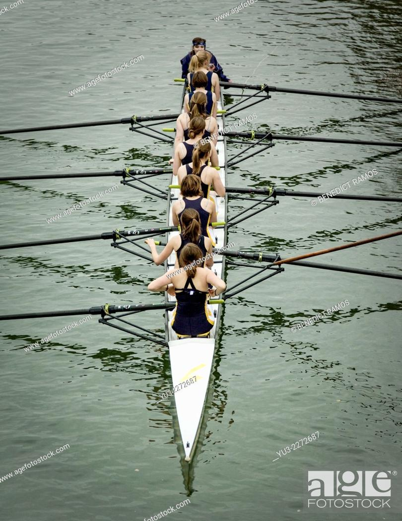 Stock Photo: Women's rowing eight in student competition, Oxford, England, UK.