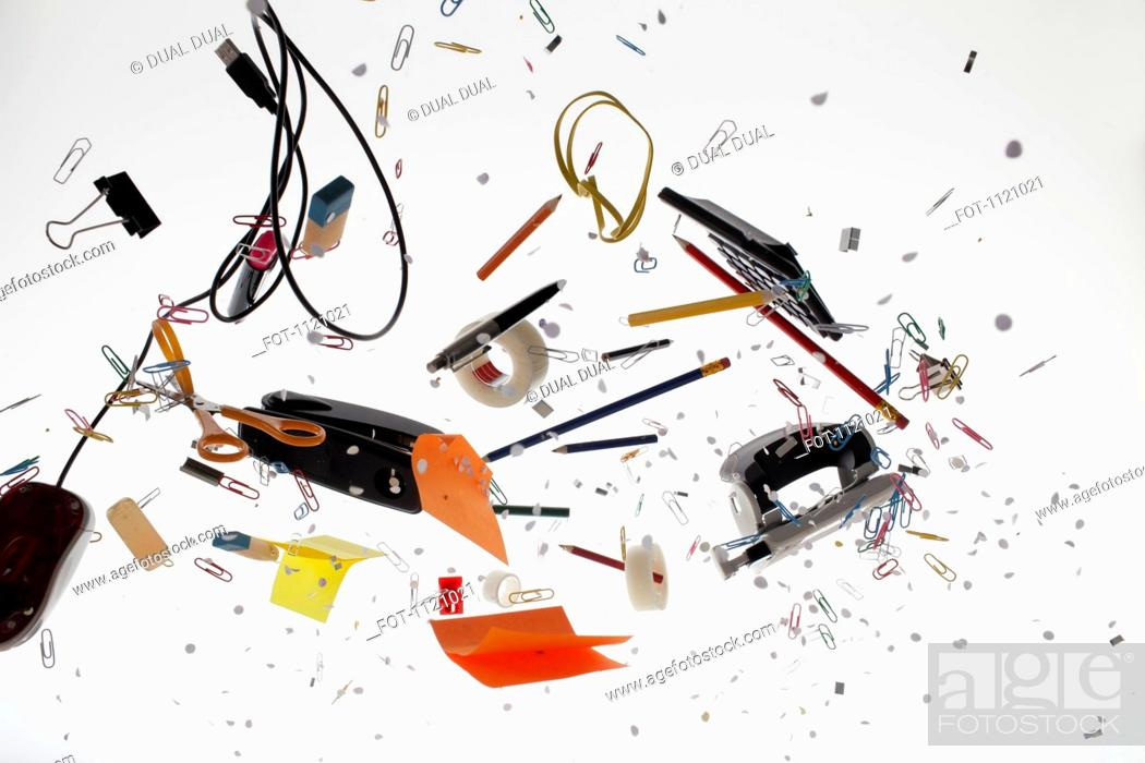 Stock Photo: Office supplies against a white background.