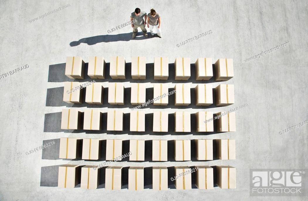 Stock Photo: Couple looking at lines of boxes.