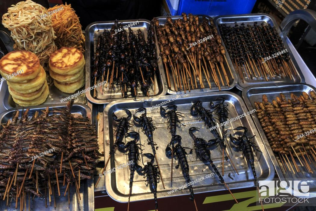 Stock Photo: Chengdu, China - December 12, 2018: Insects and scorpions sold in a street market in Chengdu.