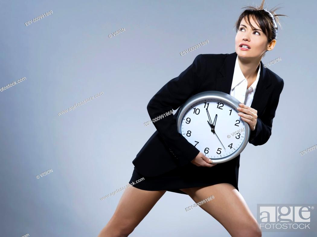 Stock Photo: beautiful woman on isolated backgound holding a clock.