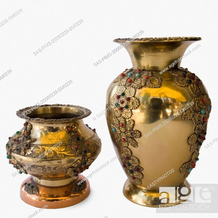 Stock Photo: Close-up of antique decorative metal pots.
