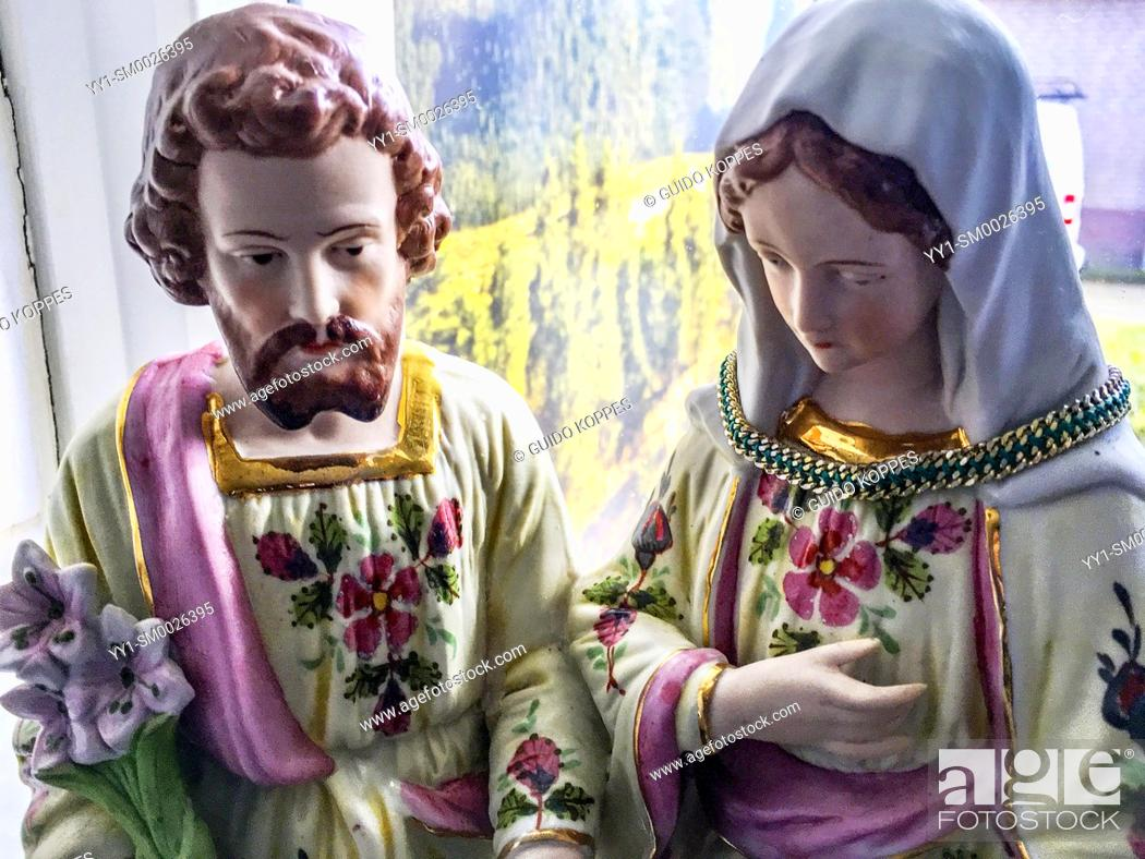 Stock Photo: Dongen, Netherlands. Statue of Saint Joseph and Mother Maria near the kitchen window inside a religious household.