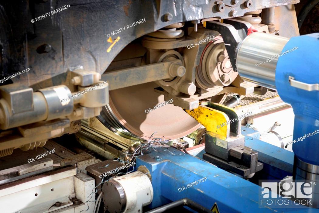 Stock Photo: Detail of locomotive wheel lathe in train works.