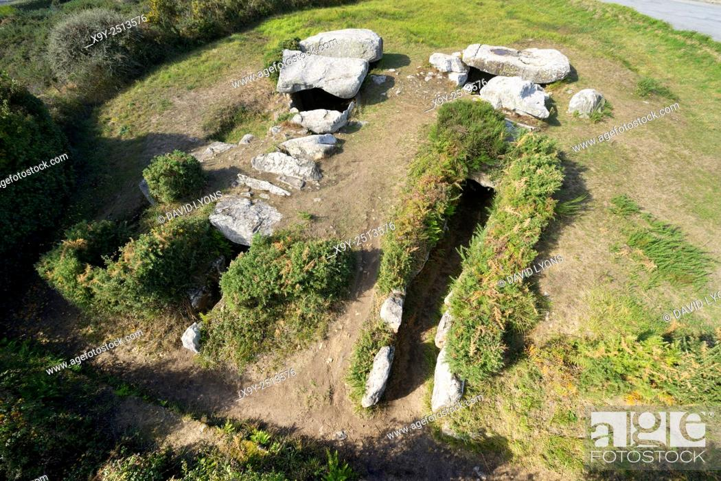Stock Photo: The 6000 year old Dolmens of Rondossec. Plouharnel, Brittany, France. 3 parallel passage graves in large circular cairn.