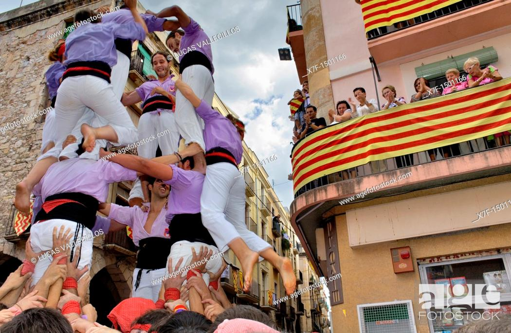 Stock Photo: Colla Jove Xiquets de Tarragona 'Castellers' building human tower, a Catalan tradition Festa de Santa Tecla, city festival  Plaça de les Cols Tarragona, Spain.