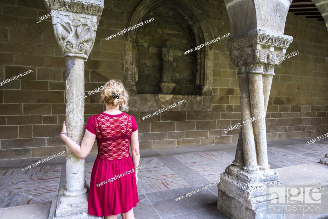 Stock Photo: Woman in a cloister. San Pedro de la Rua church. Estella. Navarre, Spain, Europe.