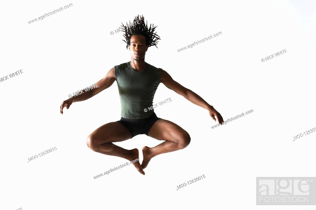 Stock Photo: Ballet dancer leaping in mid-air.