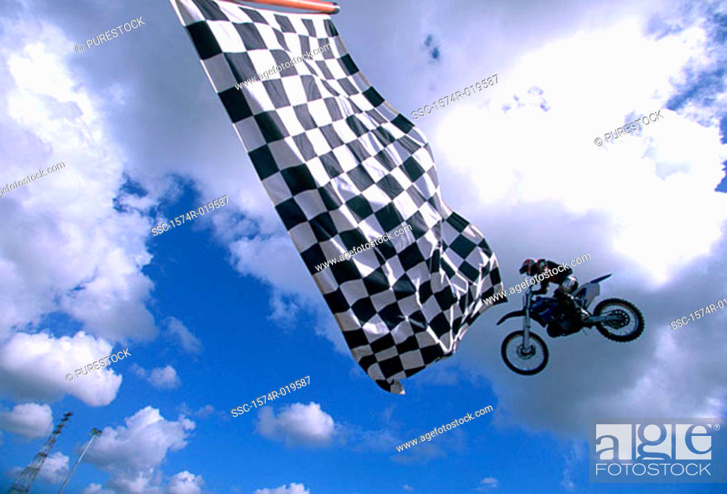 Stock Photo: Low angle view of a man performing stunts on a motorcycle.