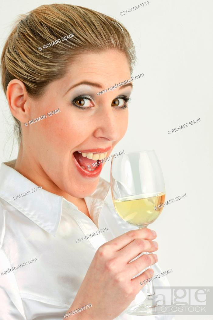 Stock Photo: portrait of young woman with a glass of white wine.