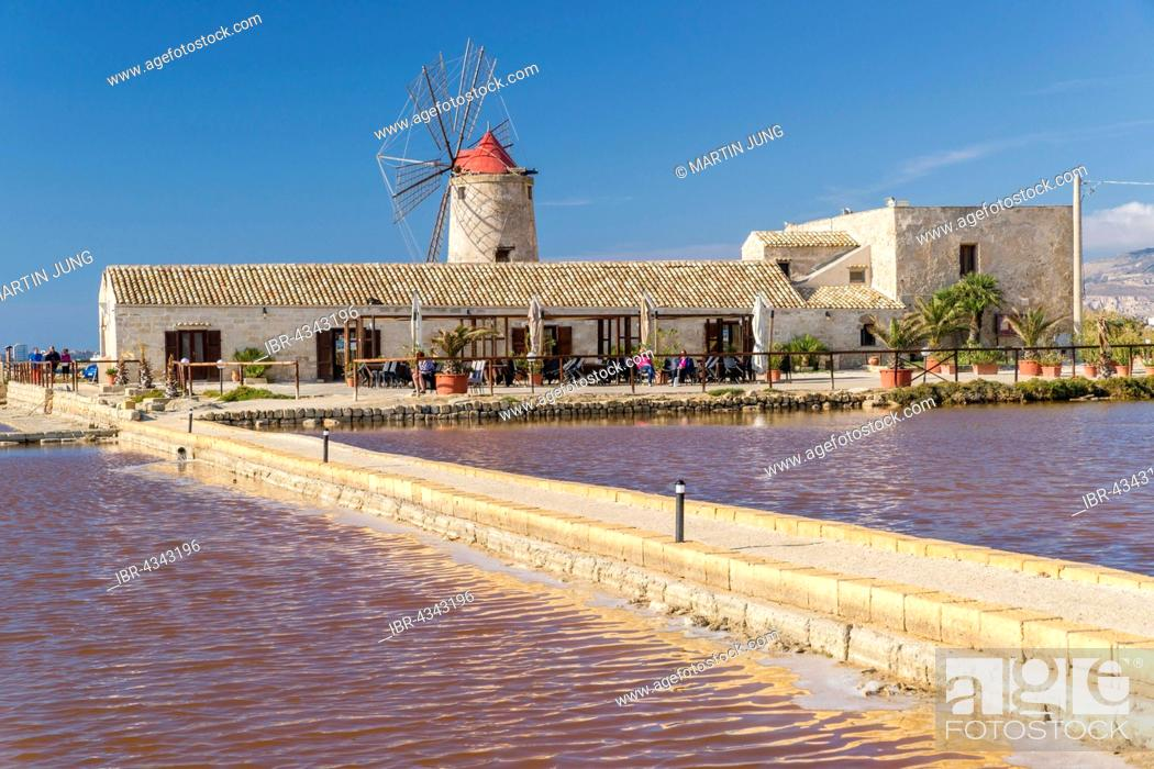 Stock Photo: Windmill in Culcasi saltworks, Natural Reserve of saltworks with salt marshes, Via del Sale, Salt Road, Nubia, Province of Trapani, Sicily, Italy.