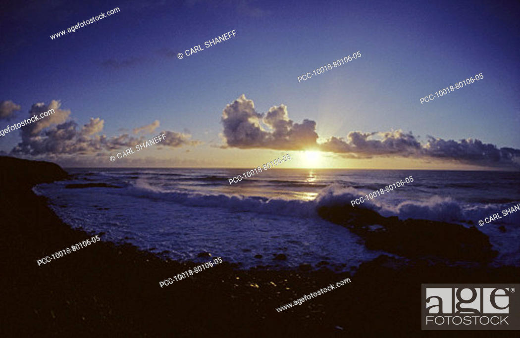 Stock Photo: Cloudy blue sky over ocean at sunset from tropical beach.