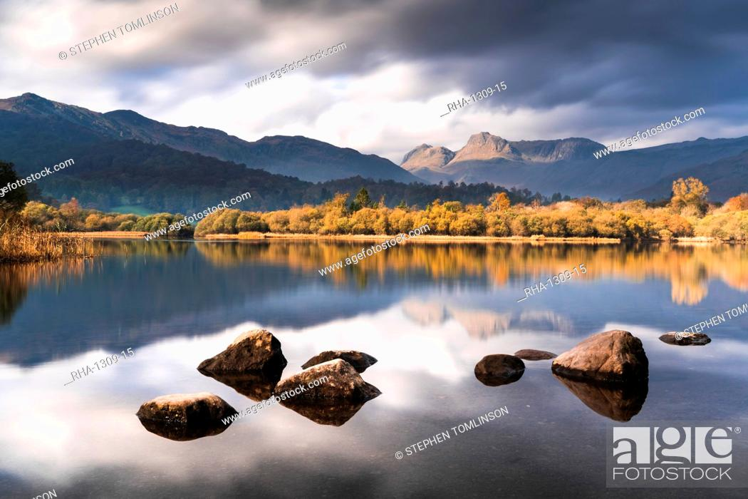 Stock Photo: The Langdale Pikes reflected in the tranquil River Brathay, autumn, Elterwater, Lake District National Park, UNESCO World Heritage Site, Cumbria, England.