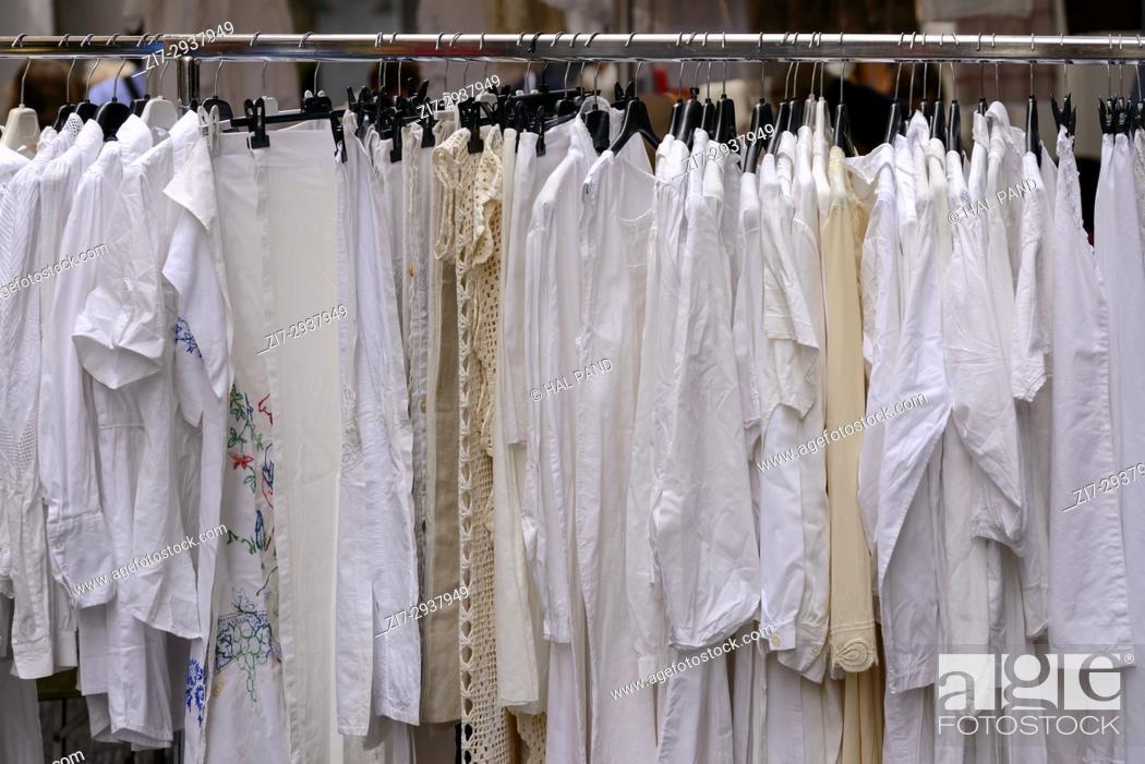 Stock Photo: white vintage clothes on coat rack on sale in bric-a-brac antiques street market, shot at Mediterranean little town of Chiavari, Genova, Liguria, Italy.