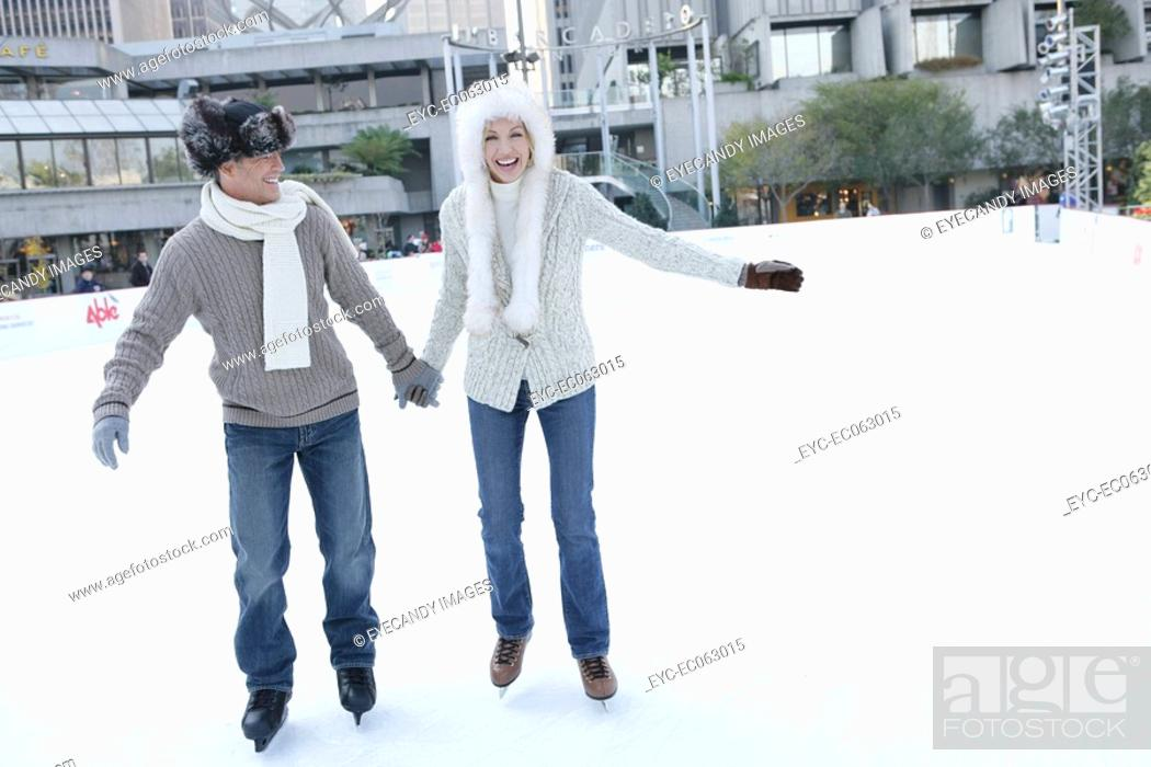 Stock Photo: Mature couple ice skating together.