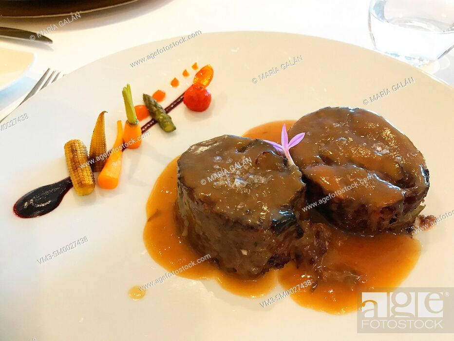 Stock Photo: Meat with vegetables sauce.