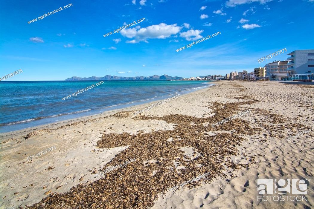 Stock Photo: Empty sandy Mediterranean beach in spring sunshine in Majorca, Spain.