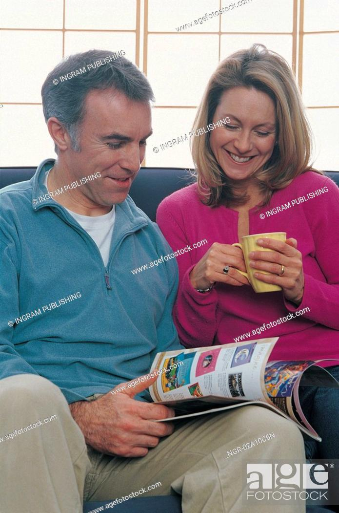 Stock Photo: couple reading a magazine together.