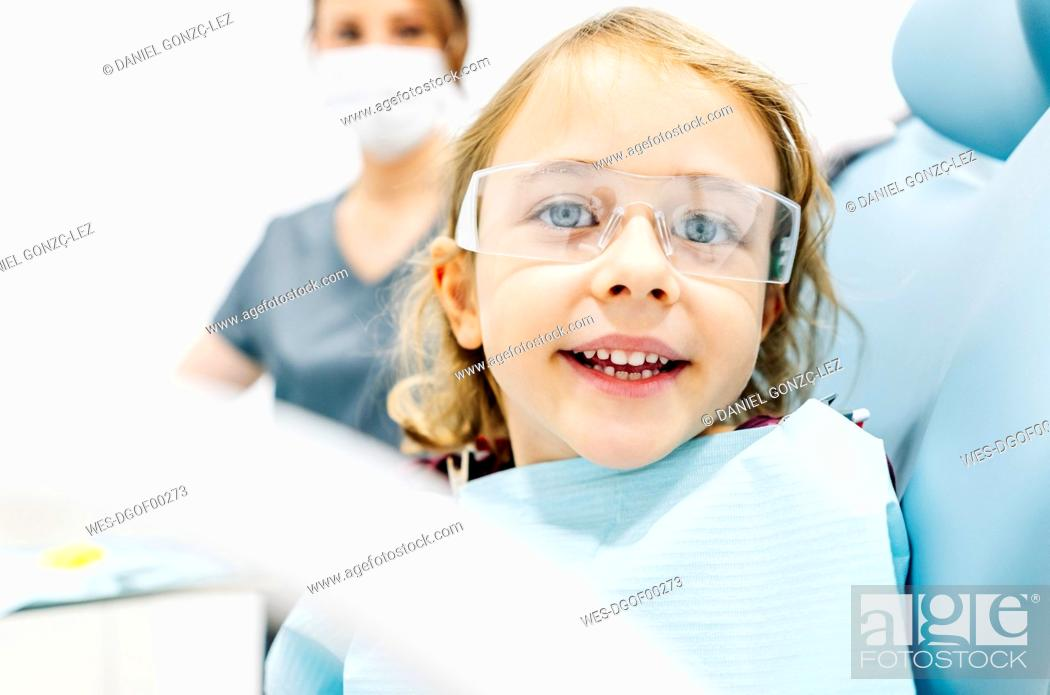 Stock Photo: Portrait of smiling girl at the dentist.