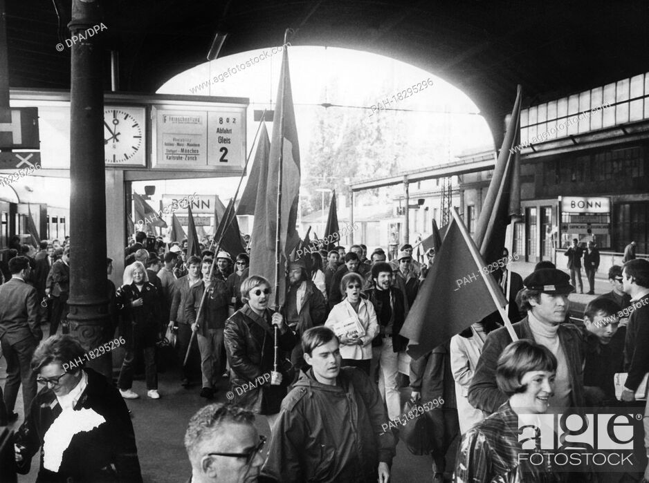 Stock Photo: Demonstrators with red flags after the arrival of the special train at the station in Bonn on 11 May 1968. A special train of the German Reichsbahn (GDR) left.