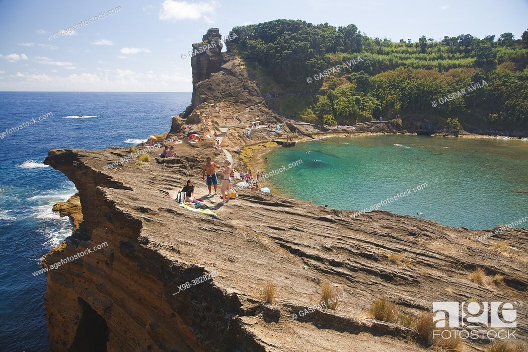 Stock Photo: People sunbathing on the islet of Vila Franca do Campo off the coast of Sao Miguel, Azores islands, Portugal.