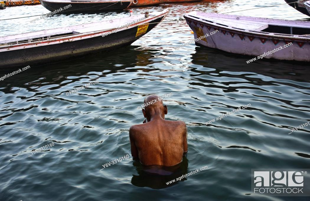 Stock Photo: Hindu man bathing in the Ganges river ( Varanasi, India).