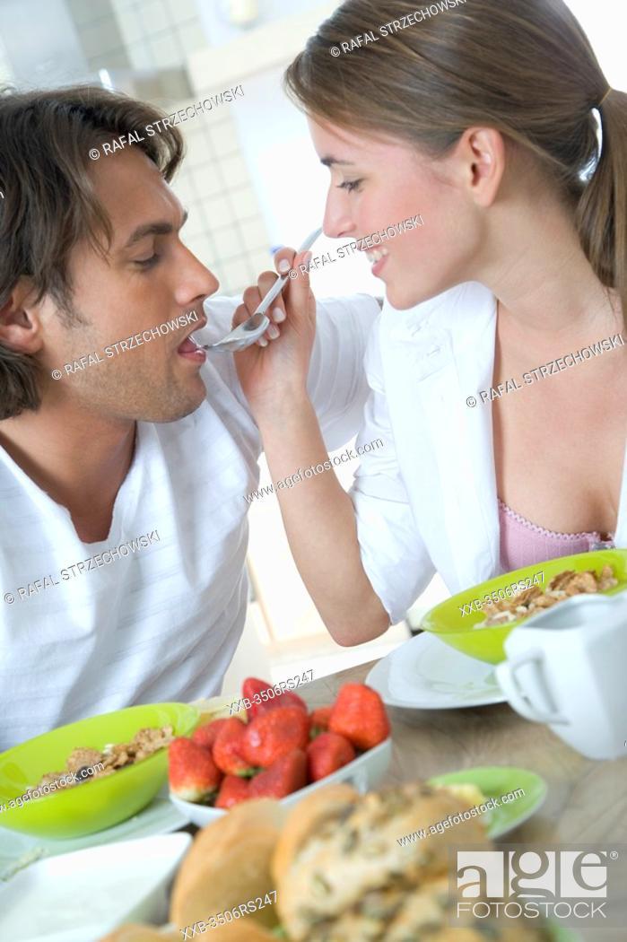 Stock Photo: woman feeding men.